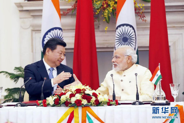 President Xi Jinping and Indian Prime Minister Narendra Modi shake hands at a press conference in New Delhi, India, Sept 18, 2014. (Photo/Xinhua)