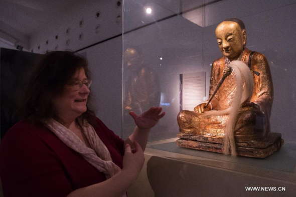 A Chinese Buddha statue with the mummified body of a Buddhist monk inside is on display at the Hungarian Natural History Museum in Budapest, Hungary on March 3, 2015.  (Xinhua/Attila Volgyi)